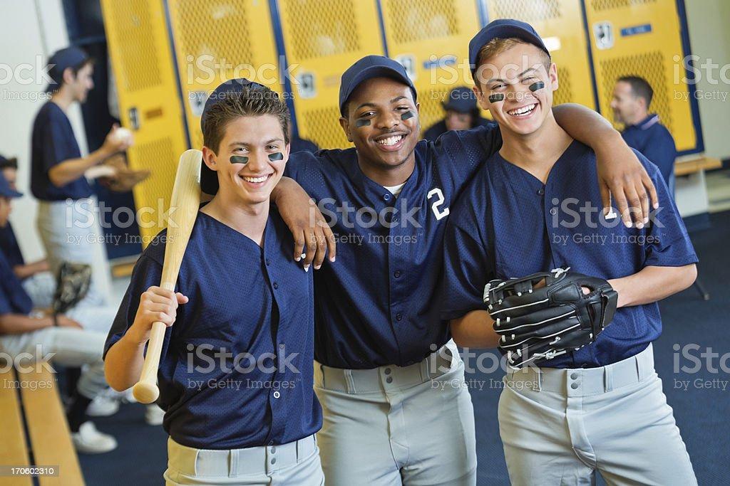 Diverse high school baseball players in locker room stock photo