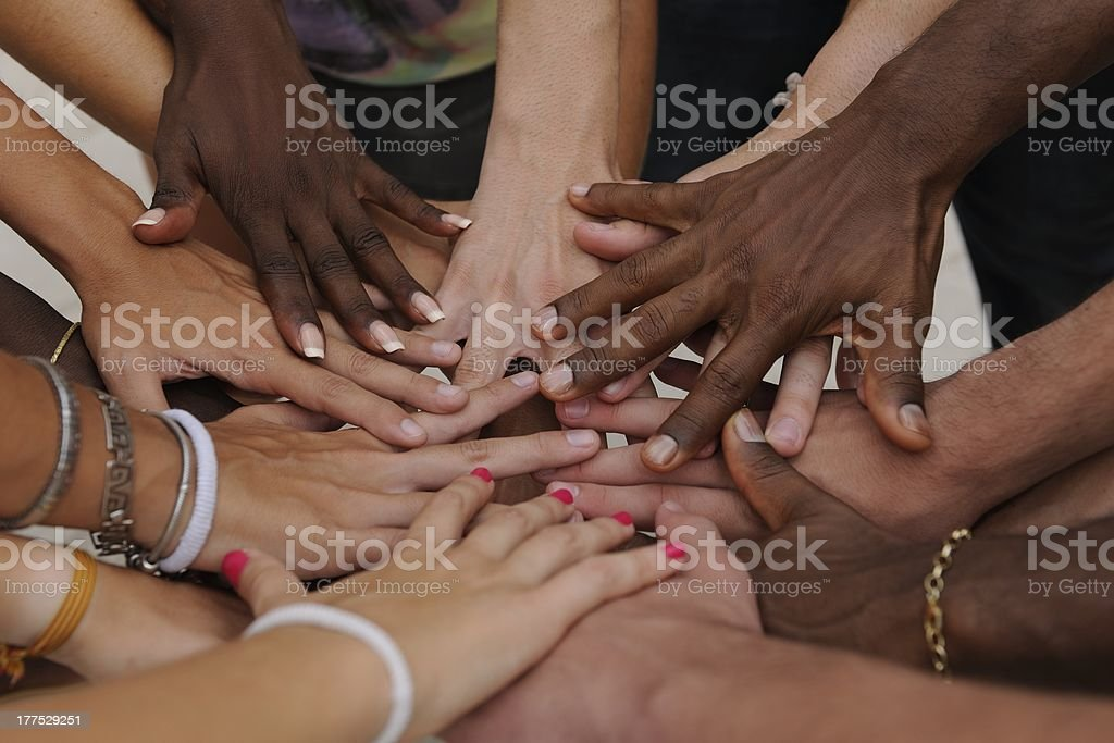 Diverse human hands showing unity stock photo