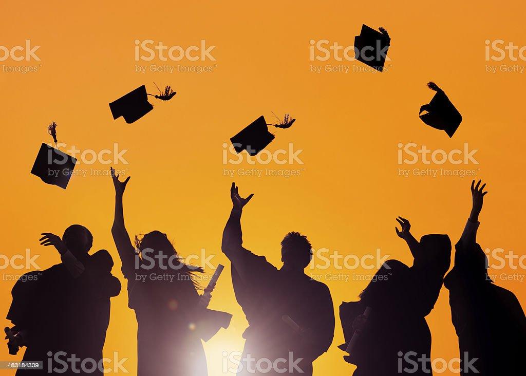 Diverse International Students Celebrating Graduation stock photo