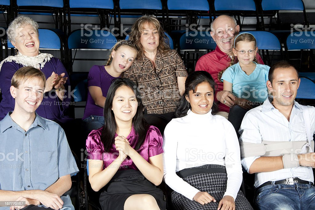 Diverse large group of people watching a game or show royalty-free stock photo