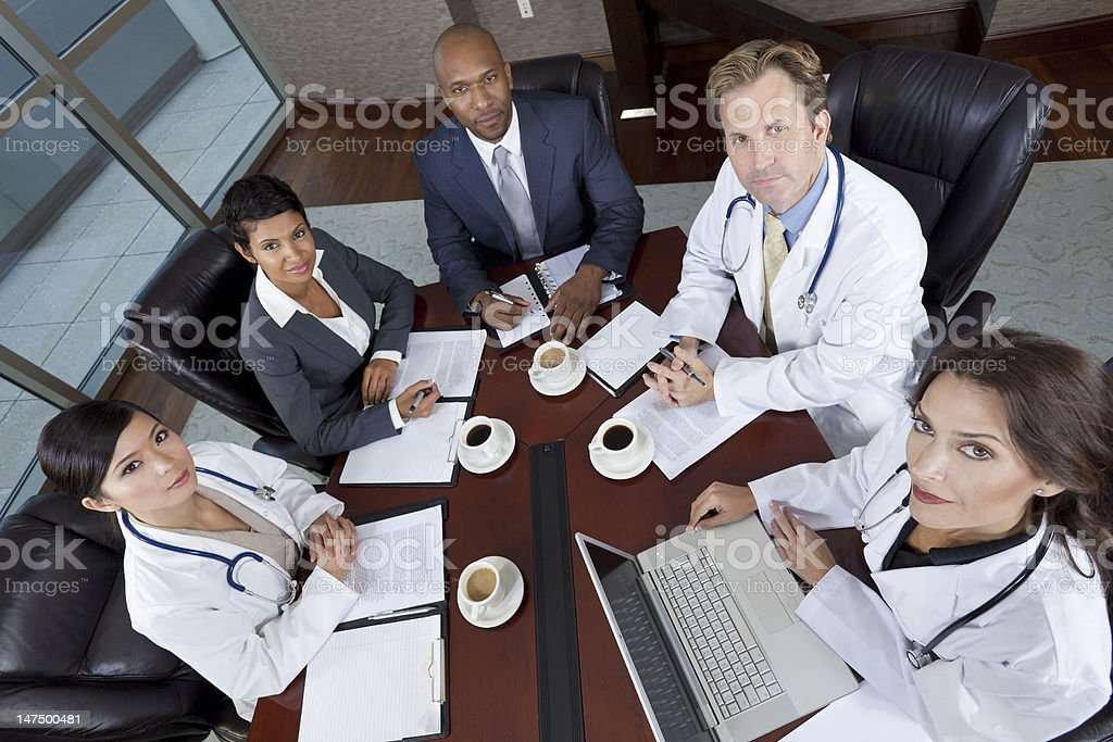 Diverse medical business team in a meeting stock photo