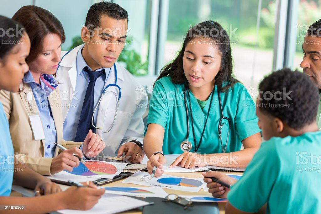 Diverse medical team meets with hospital administration stock photo