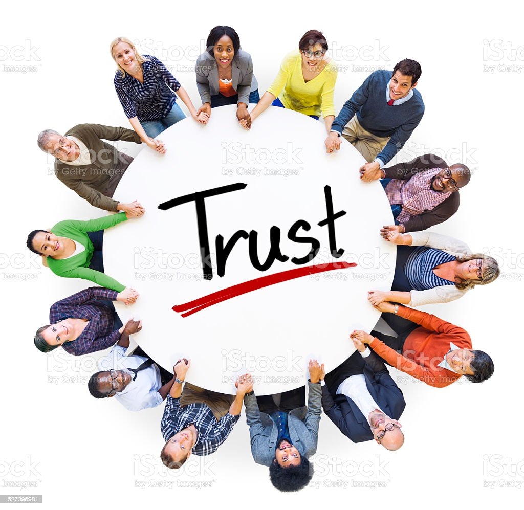 Diverse People Holding Hands Trust Concept stock photo