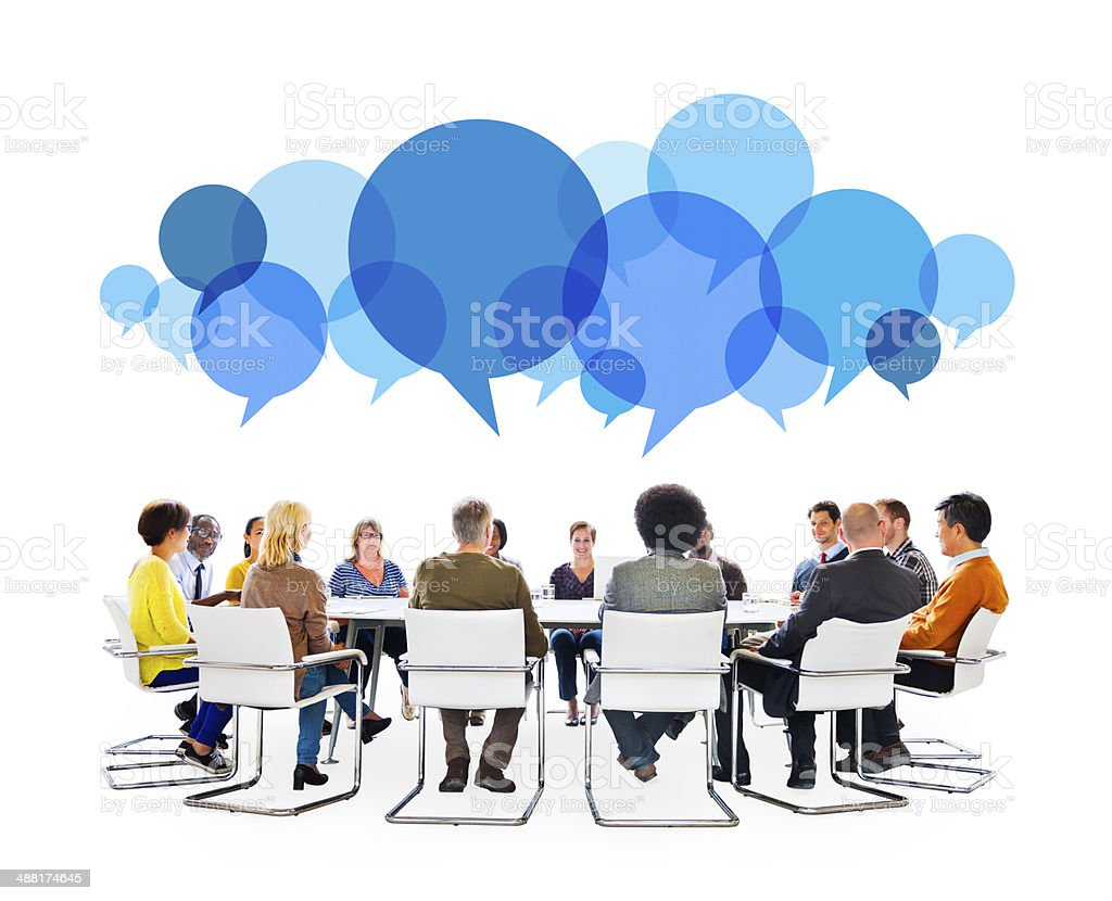 Diverse People in Meeting With Speech Bubbles stock photo