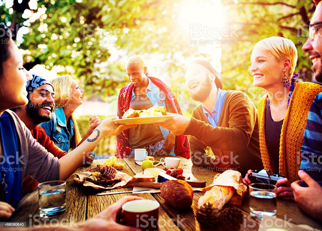 Diverse People Luncheon Outdoors Food Concept stock photo