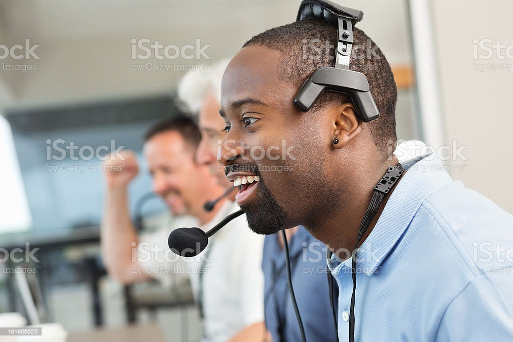 Diverse sports commentators in stadium press box during game stock photo