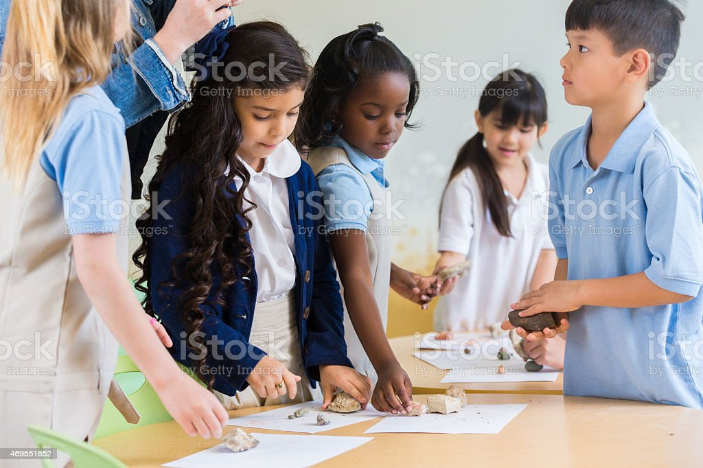 Diverse students in private elementary school science class stock photo