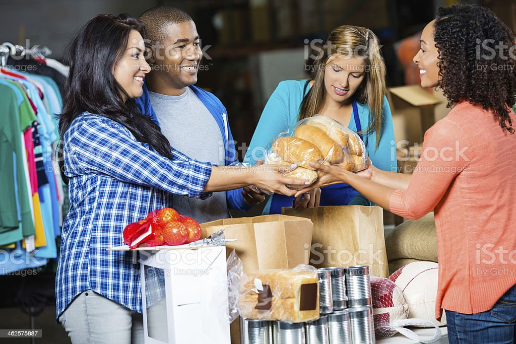 Diverse volunteers receiving donations at community food bank royalty-free stock photo