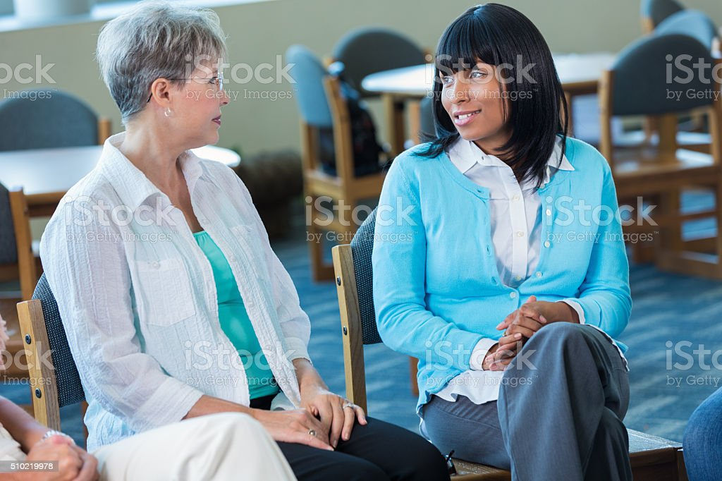 Diverse women participate in support group stock photo