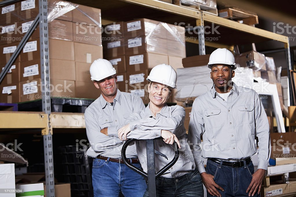 Diverse workers in warehouse royalty-free stock photo