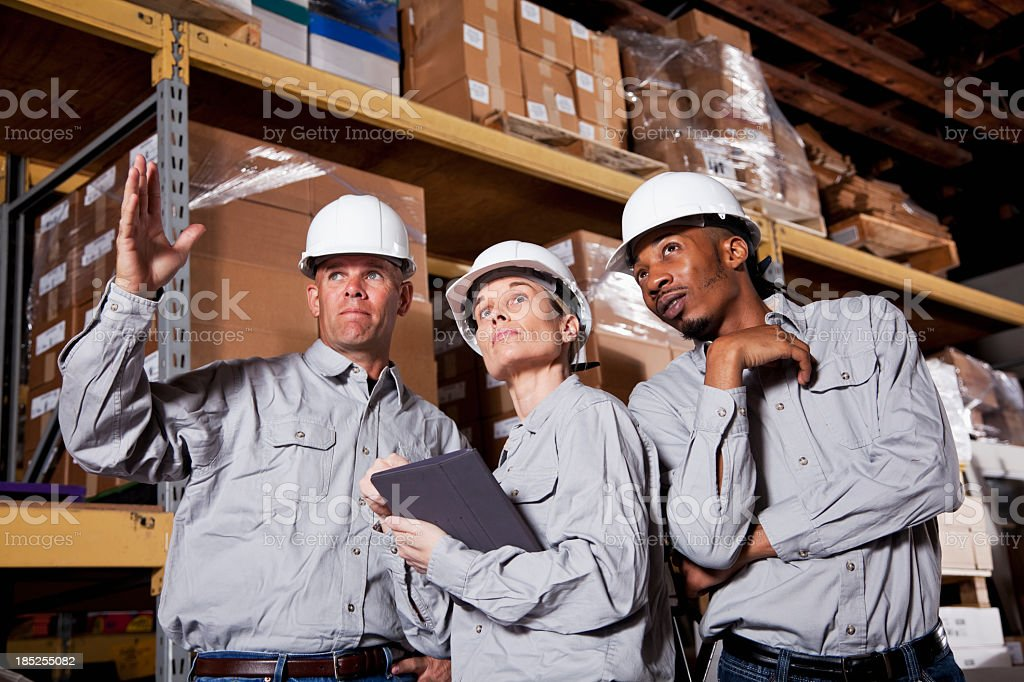 Diverse workers in warehouse stock photo