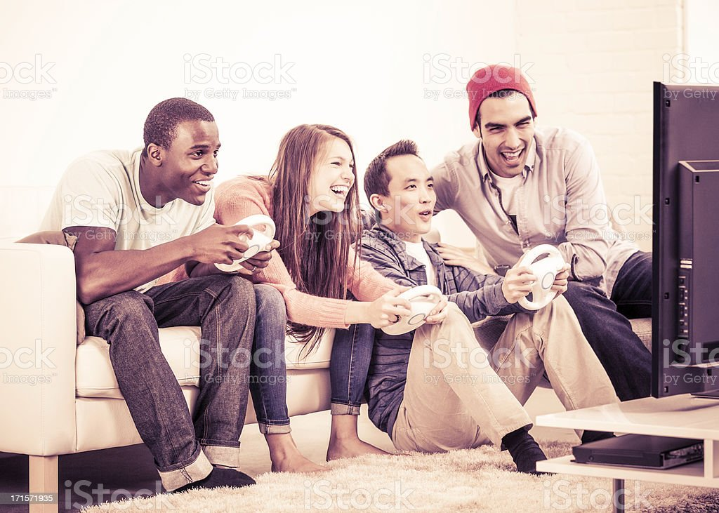 Diverse Young Adults Playing Video Games stock photo