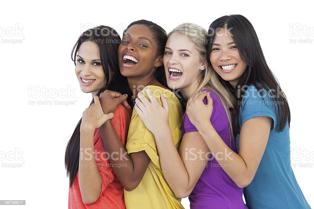 Diverse young women laughing at camera and embracing stock photo