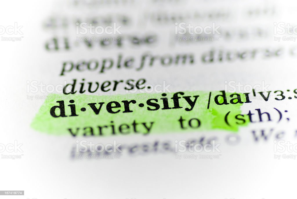 diversify defintion highligted in dictionary - sense stock photo