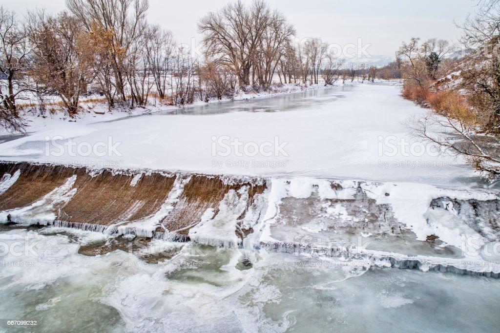 diversion dam on Poudre River stock photo