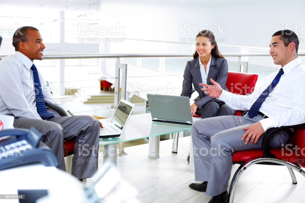 Diversity business employees discussing in big workplace. royalty-free stock photo