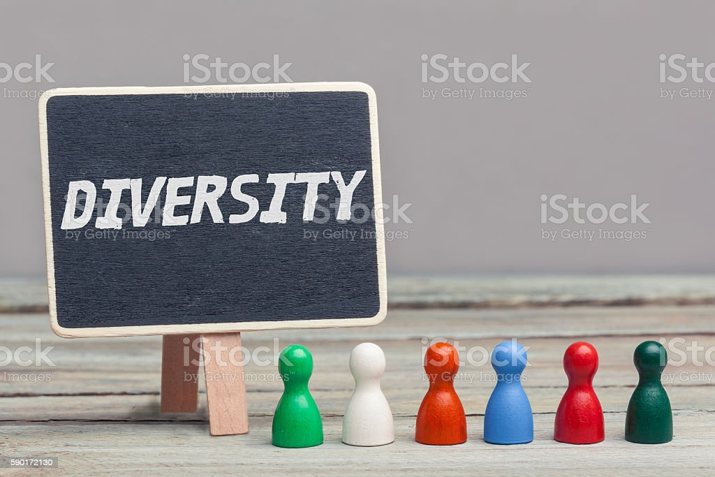 'diversity' concept, colored board pieces with chalboard stock photo