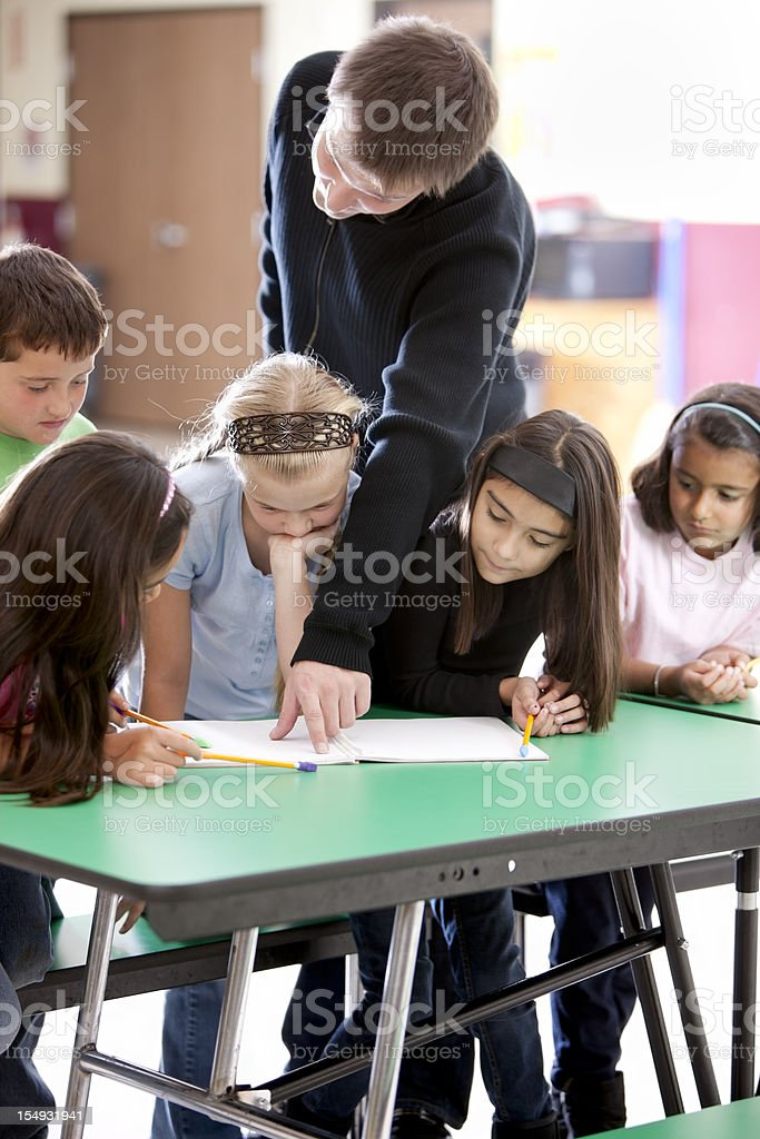 Diversity:  Ethnic Children Learning or Studying in School Education royalty-free stock photo