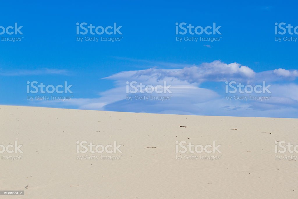 Divided photography on two part with sand and sky. Lands stock photo