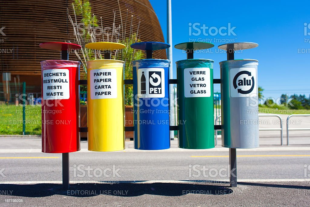 Divided recycling bins with different color and signs stock photo