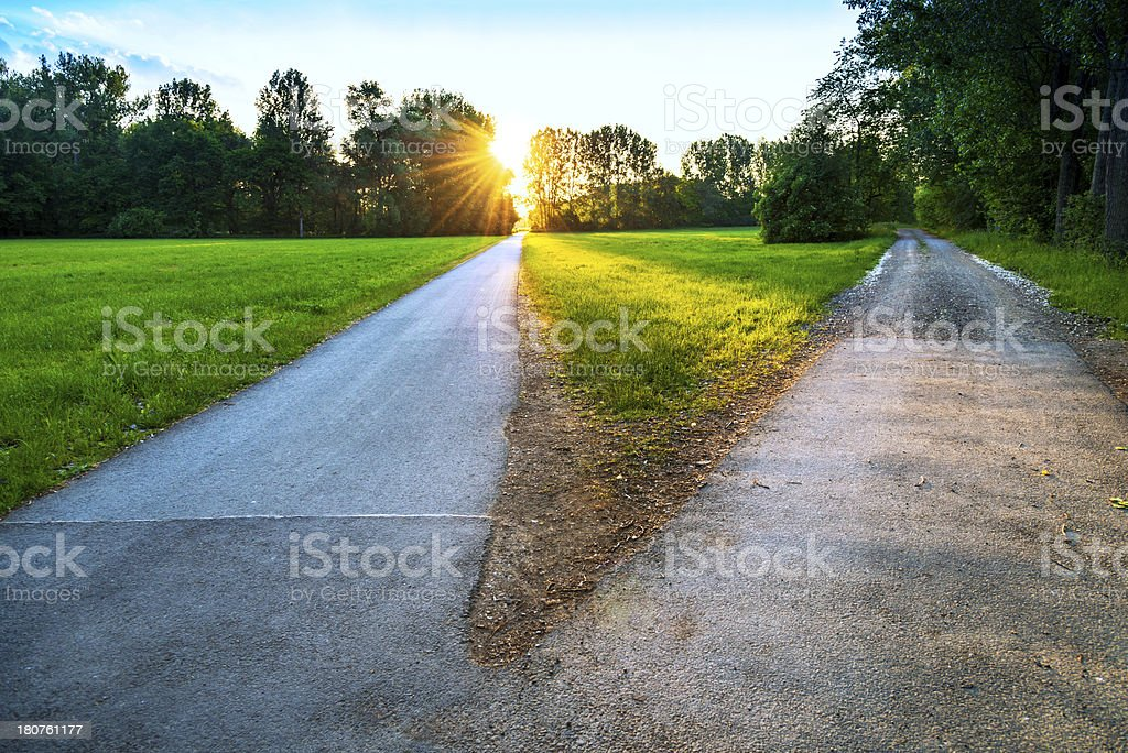 divided road on a sunny evening stock photo