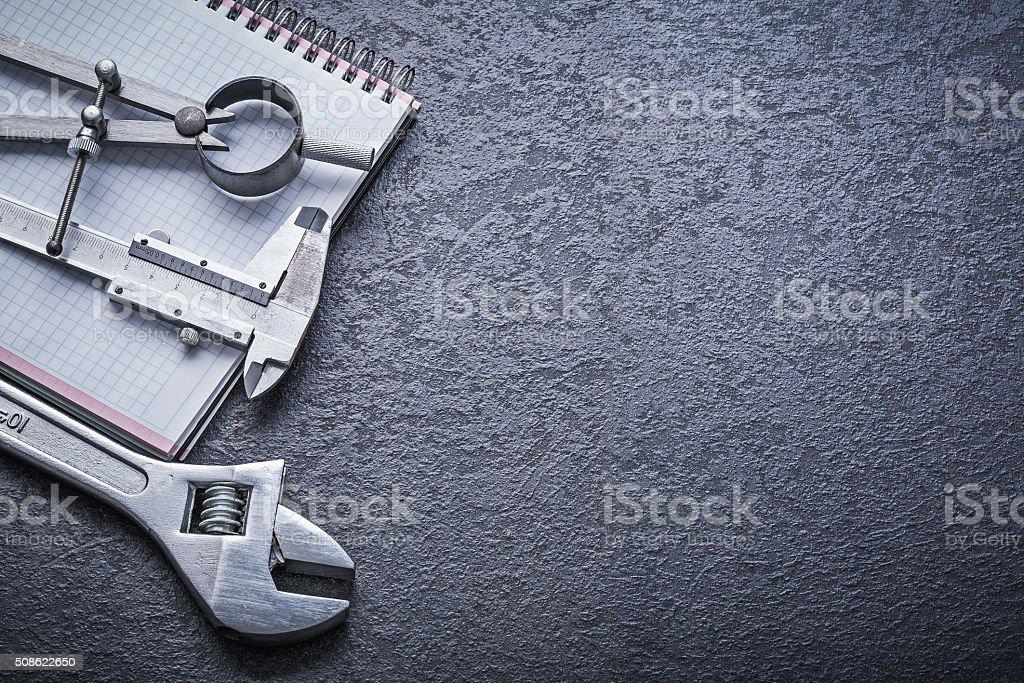 Divider calliper adjustable spanner notebook construction concep stock photo