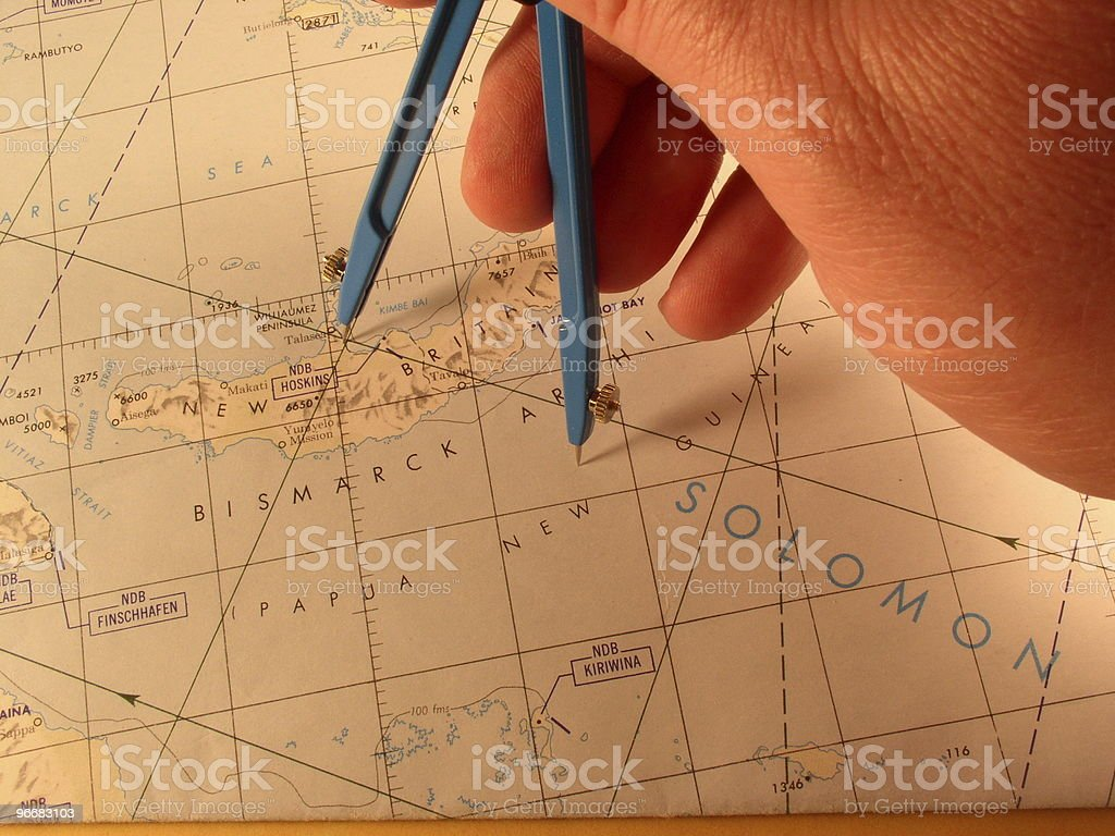 Divider measuring distance on a chart stock photo