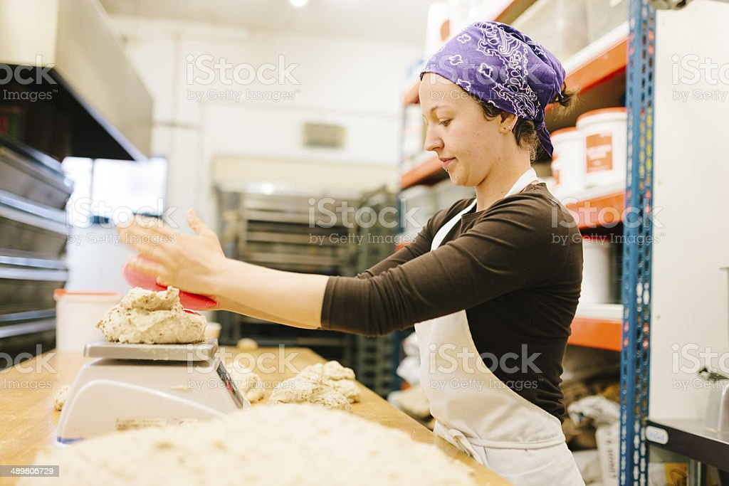 Dividing bread dough stock photo
