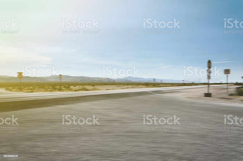 Dividing highway in the West in motion blur, Arizona, USA stock photo