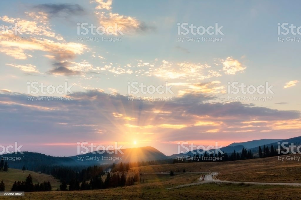 Divine sunset in the Apuseni mountains of Transylvania stock photo