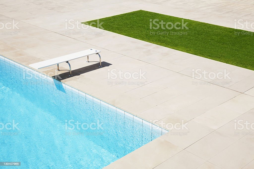 Diving board over pool stock photo