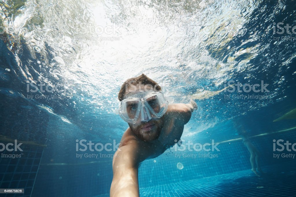 Diving deep into the blue stock photo