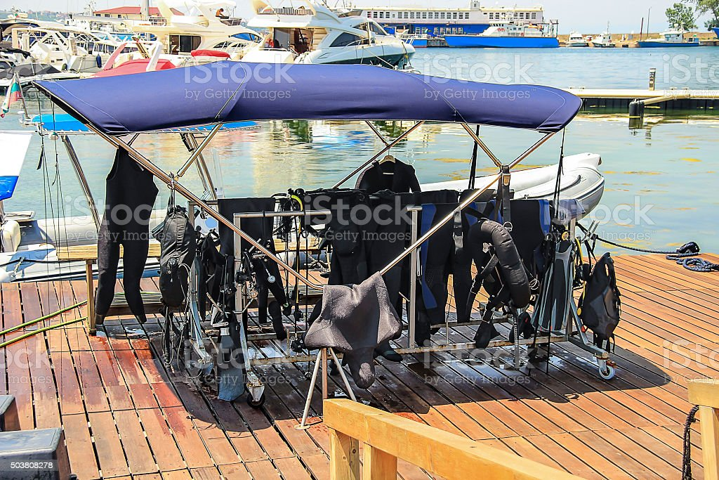 diving equipment to dry in the shade Sozopol Bulgaria stock photo