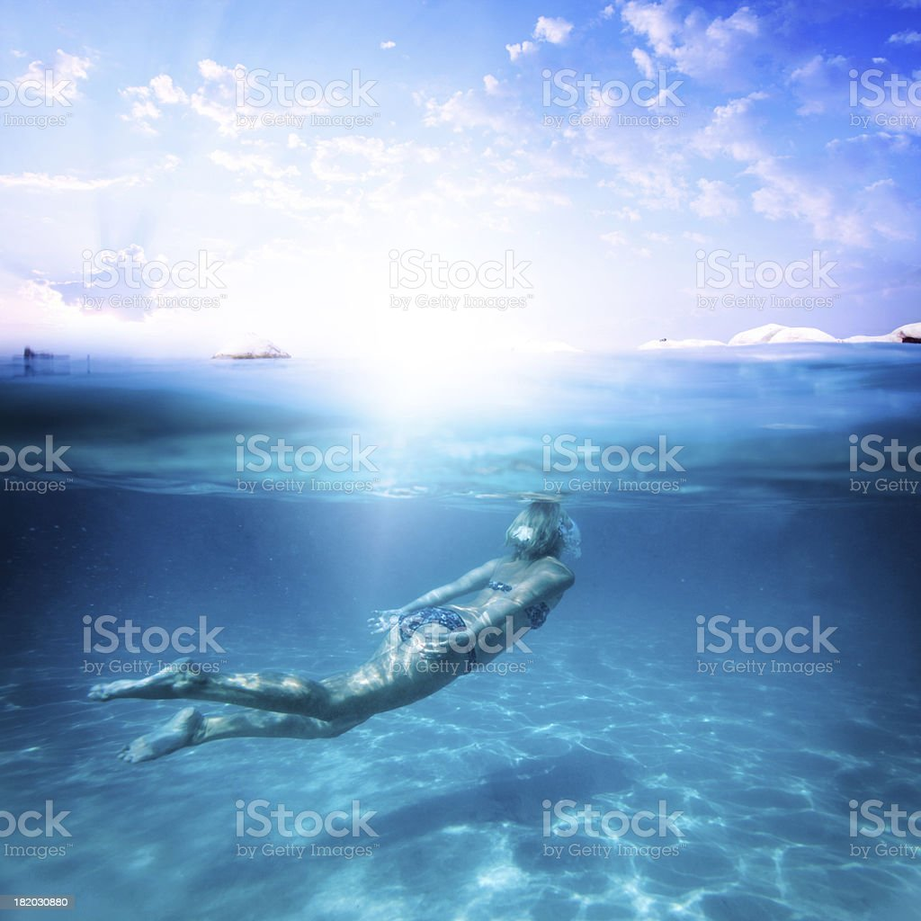Diving in a beautiful turquoise water stock photo