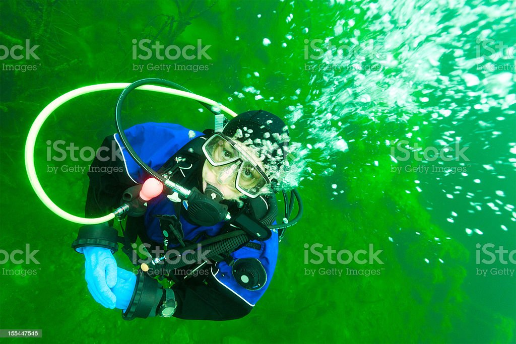 diving in the green lake stock photo
