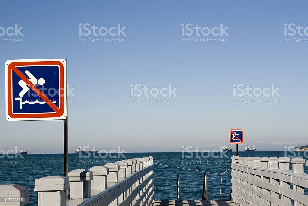 NO diving in the harbor! stock photo