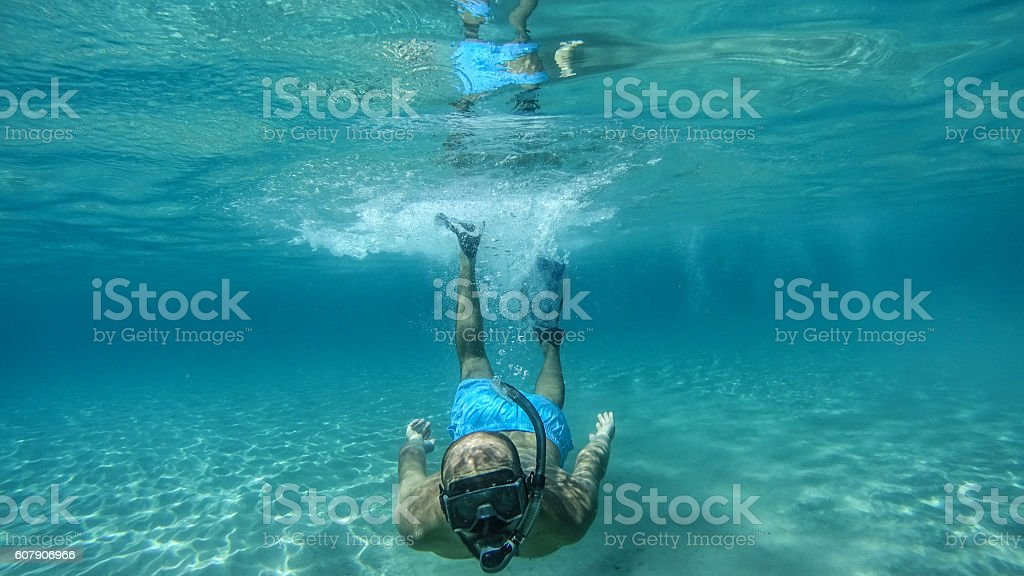 Diving in the water stock photo
