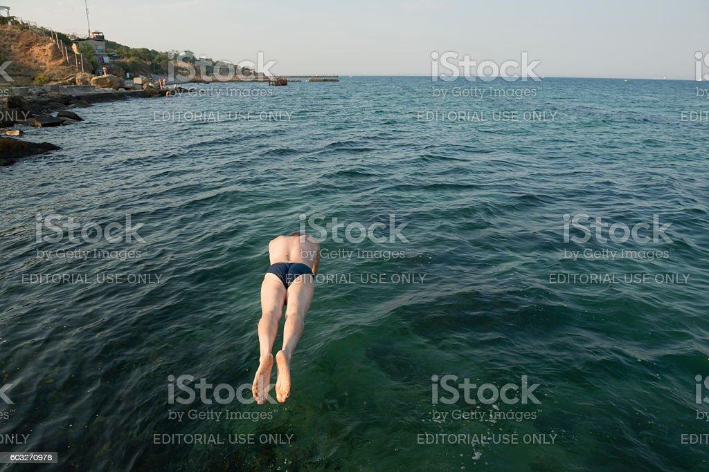 Diving into Black Sea in Odessa, Ukraine stock photo