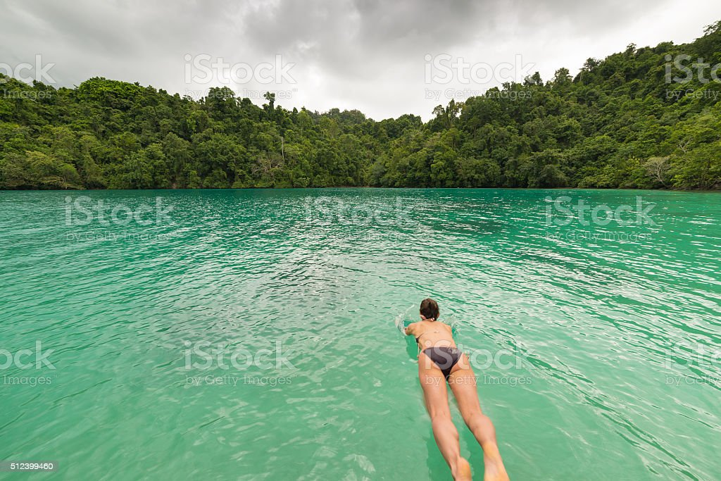 Diving into wonderful blue green tropical lagoon stock photo