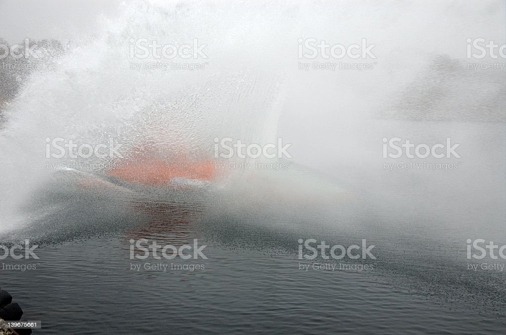 Diving lifeboat breaking water surface at great force stock photo