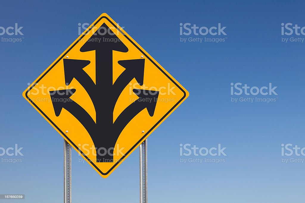 Division Ahead or Branching Out Traffic Sign Post Over Sky royalty-free stock photo