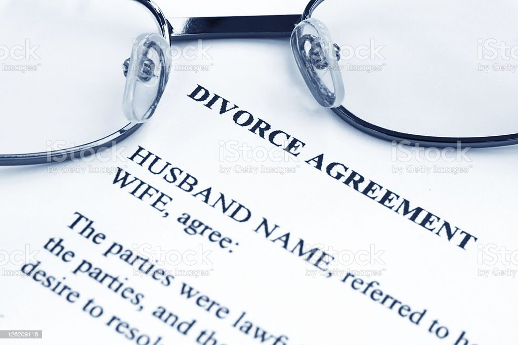 Divorce agreement template with eyeglass on top royalty-free stock photo