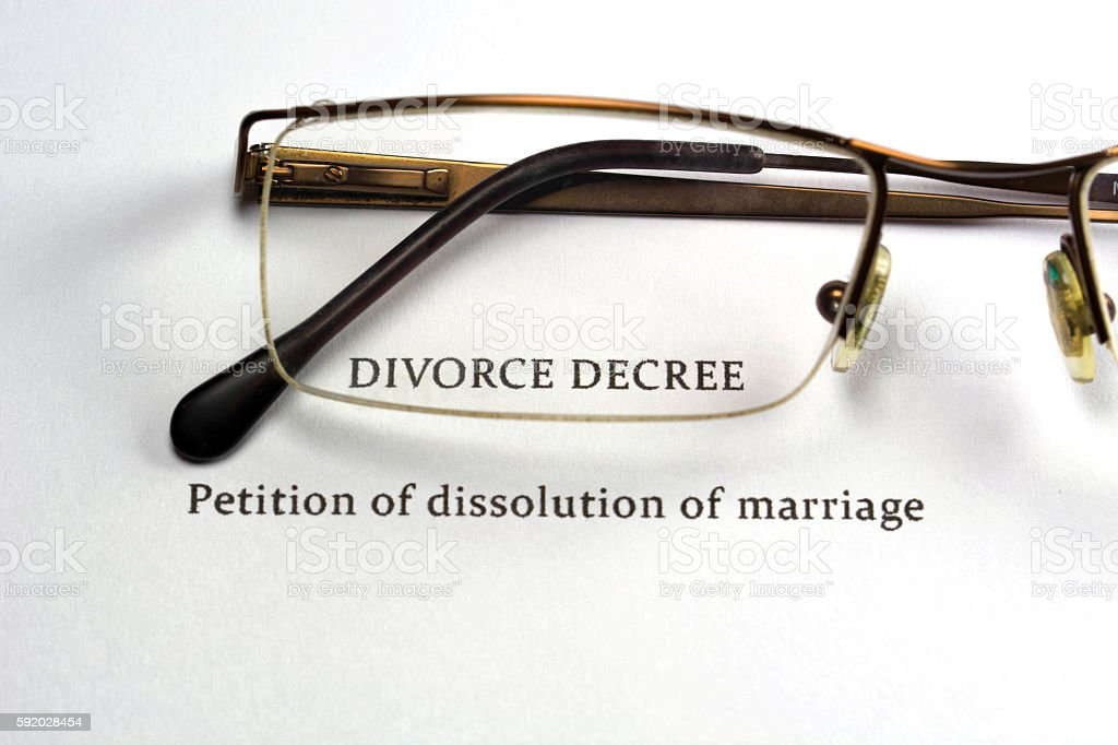 Divorce decree document through glasses. stock photo