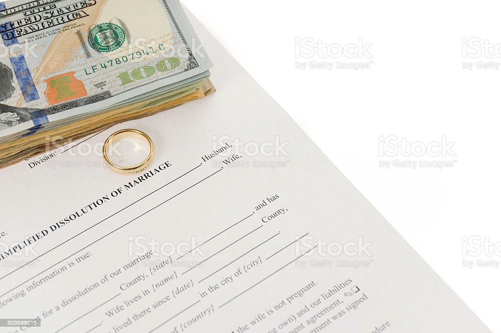 Divorce Form With Wedding Ring And U$100 Bills stock photo