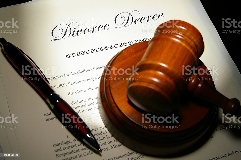 Divorce papers with a pen and gavel royalty-free stock photo