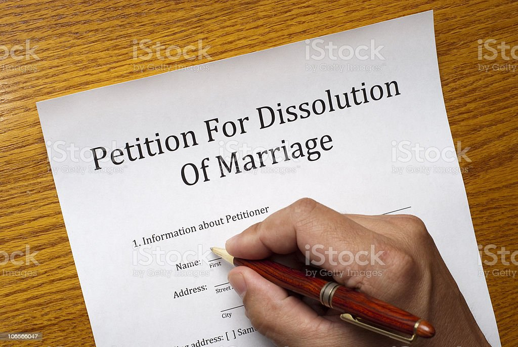 Divorce papers with hand and pen royalty-free stock photo
