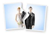 Divorce. Torn photograph of wedding cake topper.