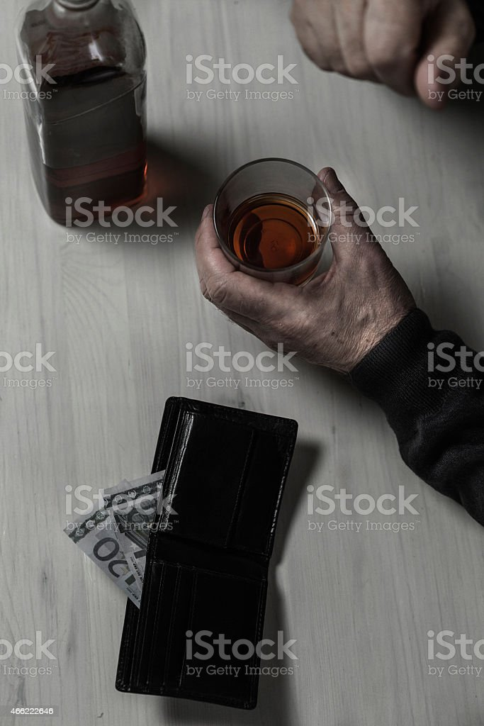 Divorced falls into alcoholism stock photo