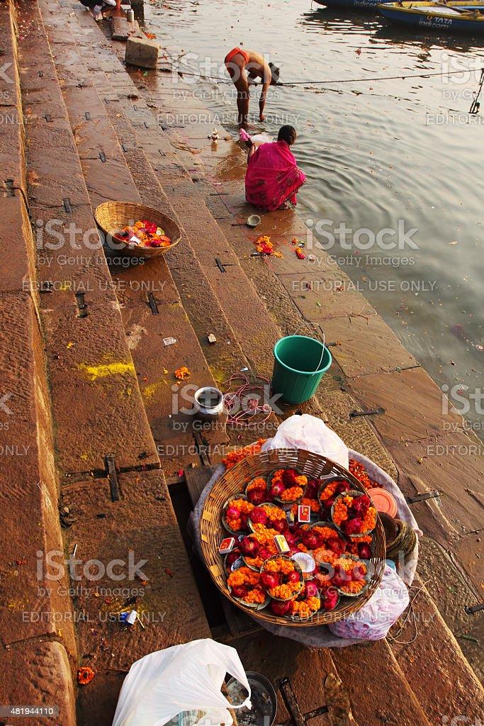 Diya and flowers for sale on Dashashwamedh Ghat of Varanasi stock photo
