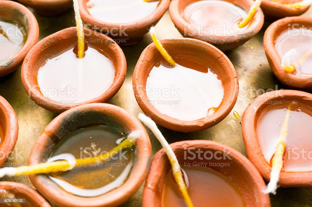 diya clay lamps filled with oil and a cotton wick stock photo